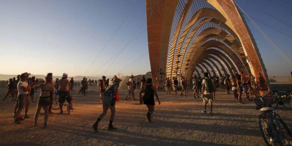 A large metal arching structure at Burning Man