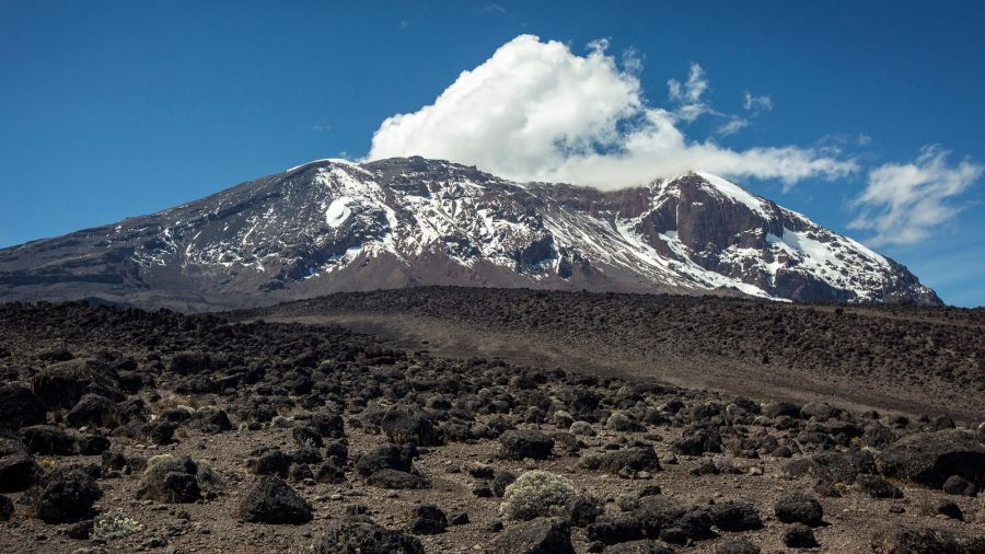 Mount Kilimanjaro with blue sky and clouds